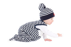 Side view of baby boy toddler in sailor clothes crawling isolate Stock Photos
