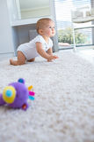 Side view of a baby crawling on carpet Royalty Free Stock Image