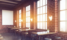 Side view of bar with poster and large windows Royalty Free Stock Photo