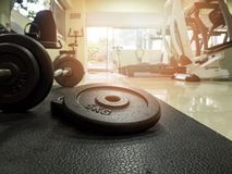 Barbell on the floor in fitness gym royalty free stock image