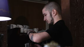 Side view of bartender pushing the button on coffee machine stock video footage