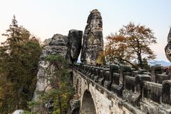 Side view of the Bastei bridge in the evening with trees royalty free stock image