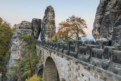 Side view bastion bridge overlooking the rock gate and trees and rock formation in the evening royalty free stock photos