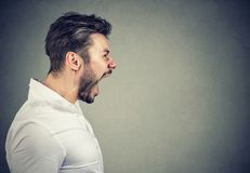 Angry young man screaming loud Royalty Free Stock Photo