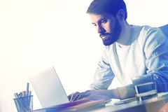 Side view of bearded man working Stock Images