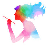 Side view of beautiful artist girl holding paint brush Stock Images