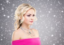 Side view of beautiful blond in pink dress wearing necklace with Royalty Free Stock Images