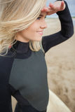Side view of beautiful blond shielding eyes at beach Royalty Free Stock Images