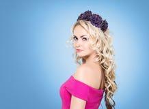 Side view of beautiful blond wearing a purple flower alike headb Royalty Free Stock Photo