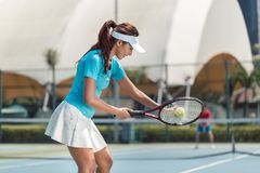 Beautiful and competitive woman smiling before starting a tennis match royalty free stock photography
