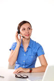 Side view of a beautiful consultant with microphone and headphone Stock Images