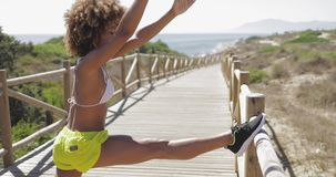 Sportive girl training on tropical pier stock footage