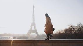 Side view beautiful happy tourist woman walking, dancing at romantic sunrise Eiffel Tower scenery in Paris slow motion.