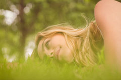 Side view of beautiful smiling woman looking away at park Royalty Free Stock Images