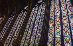 Side view Beautiful stained glass windows in the upper level interior Sainte-Chapelle Paris France. Side view Stained Glass windows at the upper level interior Stock Photo
