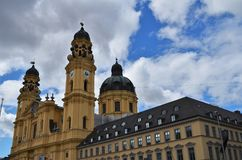 Side view of the beautiful Theatinerkirche in Munich in Germany. Side view of the beautiful Theatinerkirche at the Odeonsplatz in Munich in Germany stock photography