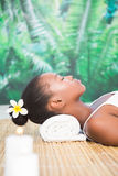 Side view of a beautiful woman on massage table Stock Photos