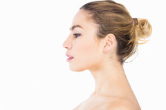 Side view of beautiful woman posing against white background Royalty Free Stock Photo