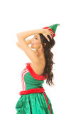 Side view of beautiful woman wearing elf clothes, touching her head Stock Photo