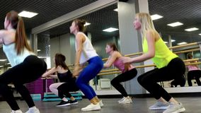 Side view of a beautiful young active women doing cardio. Side view of a beautiful young active women doing high intense workout at the gym. The concept of a stock video footage