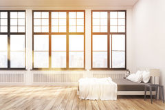 Side view of bedroom with big windows, toned Royalty Free Stock Image