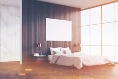 Side view of bedroom: double bed and poster, toned Royalty Free Stock Photos