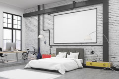Side view of bedroom interior with white walls and a poster on them. There is a large bed, an armchair, two lamps and colorful bedside tables. 3d rendering Stock Images