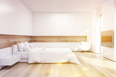 Side view of bedroom with TV set, toned Royalty Free Stock Photos