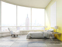 Side view of bedroom with yellow walls in New York Stock Photography