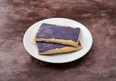 Side view of berry flavor toaster pastries on a white dish stock photos
