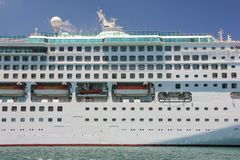 Side view of big cruise liner ship in blue water royalty free stock photo