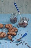 Side view of biscuits with chocolate drops and jam Royalty Free Stock Photos