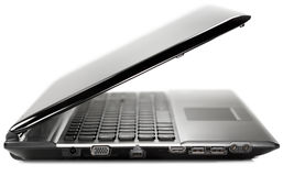 Side view of a black modern laptop on a white back Stock Photos