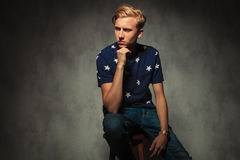Side view of a blond man thinking Royalty Free Stock Image