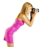 Side view of a blonde photographing Stock Photography