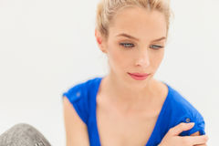 Side view of a blonde woman looking away Royalty Free Stock Image