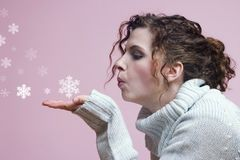 Side view blowing snowflakes. Snowflakes being blown from the hand Royalty Free Stock Images