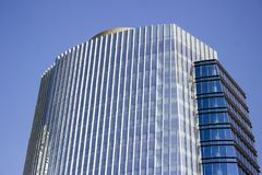Side view of a blue modern corporate high-rise building with a striped design. stock photos