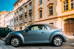 Side View Of Blue Volkswagen New Beetle Cabriolet Car Parked. Prague, Czech Republic - September 23, 2017: Side View Of Blue Volkswagen New Beetle Cabriolet Car Royalty Free Stock Image
