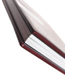 Side view of book with leatherette cover on white backgrounds Stock Images