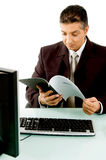 Side view of boss looking the document Stock Images