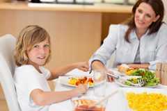 Side view of boy sitting at the dinner table Royalty Free Stock Photo