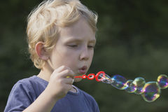 Side view of a boy with soap bubbles. Stock Photography