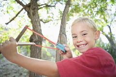 Side View Of Boy Using Slingshot Stock Image