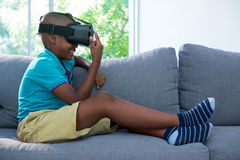 Side view of boy wearing virtual reality headset at home Royalty Free Stock Image