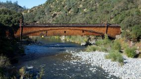 Bridgeport Covered Bridge. Side view of the bridgeport Covered Bridge at South Yuba River in California, USA. This bridge has the longest clear span of any Royalty Free Stock Photo
