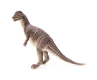Side view brown Dilophosaurus toy on white background Stock Photo