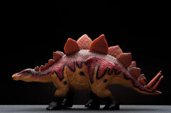 Side view brown stegosaurus toy Stock Photography