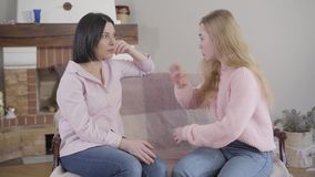 Side view of brunette Caucasian woman listening carefully to her adult daughter talking emotionally. Teen daughter