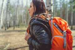 Traveling woman with backpack in woods royalty free stock image